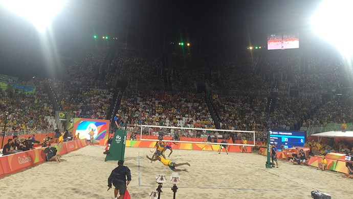 Brazilians take their beach volleyball seriously. Music, lights and hype dancers throughout the stadium all help turn a simple sporting event into full scale entertainment.