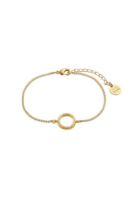 "Hammered Circle Karma Bracelet, $79, <a href=""http://nicolefendel.com.au/product/new/hammered-circle-karma-bracelet/"" target=""_blank"">Nicole Fendel</a>."