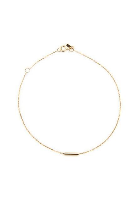 "Gold Tube Bracelet, $245, <a href=""https://www.sarahandsebastian.com/collections/women/products/tube_bracelet_yellow_gold"" target=""_blank"">Sarah & Sebastian</a>."