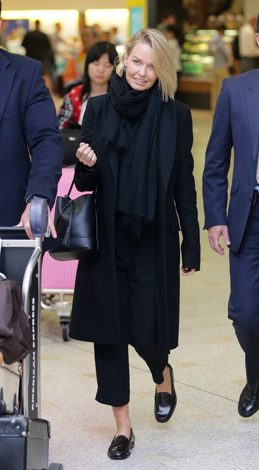 Lara Worthington sticks to her uniform of all black.