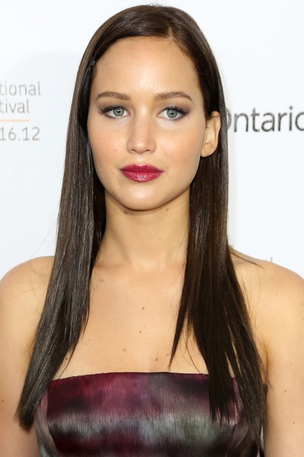 September 2012. Sleek, straight hair and a berry lip to match her Dior dress at a <em>Silver Linings Playbook</em> premiere. She went on to win an Oscar for her performance.