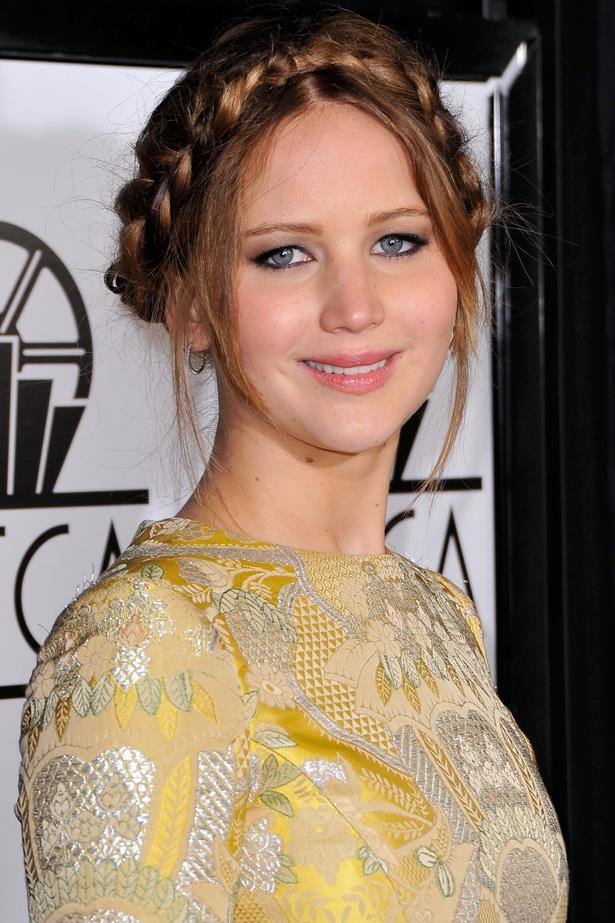 January 2013. With a simple smokey eye and her newly auburn locks twisted up into a loose braid, JLaw looks effortless at an awards ceremony in LA.