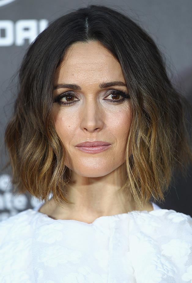 """<p><strong>Day Two: Add A Wave (Inspired By Rose Byrne)</strong> <p>Second-day hair is perfect for holding a wave. Use your preferred hot iron tool (tip: a small or travel-sized straightener is ideal for short hair) to create loose waves on the top layer of your hair. The key is to avoid tight ringlets if you want that cool, tousled effect. Spray with a dry texturising spray for light, touchable hold at the end. <p>Wave Spray, $40, Ouai at <a href=""""http://www.sephora.com.au/products/ouai-wave-spray-150ml"""">sephora.com.au</a>."""