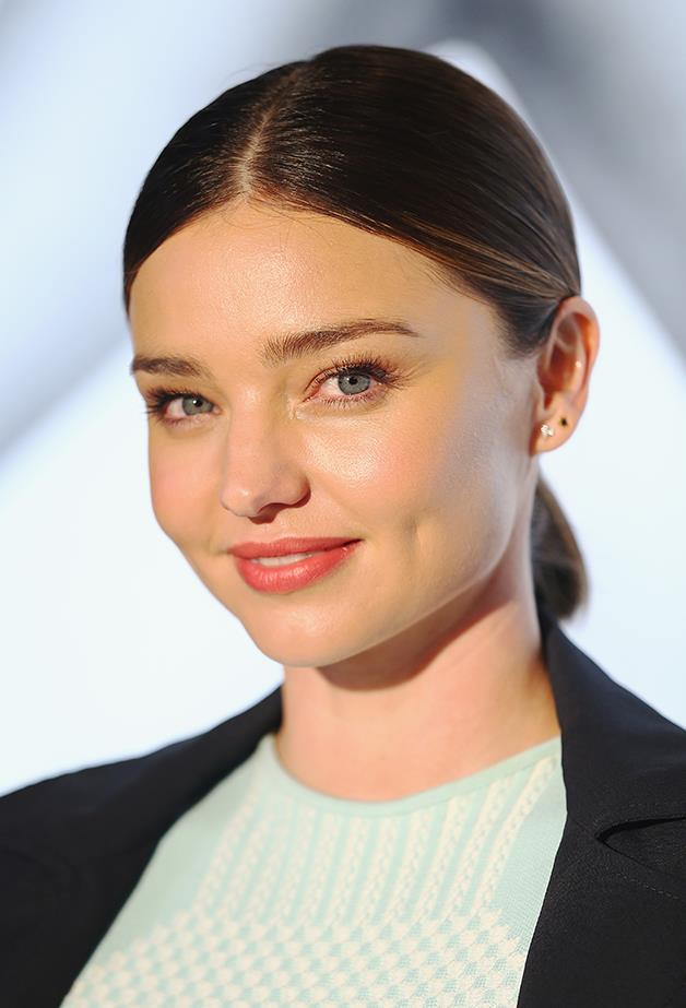 """<p><strong>Day Seven: Low Sleek Pony (Inspired By Miranda Kerr)</strong> <p>If you made it through a whole week without washing your hair, congratulations! If you didn't, we don't blame you. After all that wavy hair action it might be time to pare things back with a simple style. Use a smoothing serum to add some sleekness to your hair, give it a strong parting and secure with an elastic. Too easy! <p>Smooth Again, $49.95, Kevin Murphy at <a href=""""http://www.adorebeauty.com.au/kevin-murphy/kevin-murphy-smooth-again.html"""">adorebeauty.com.au</a>."""