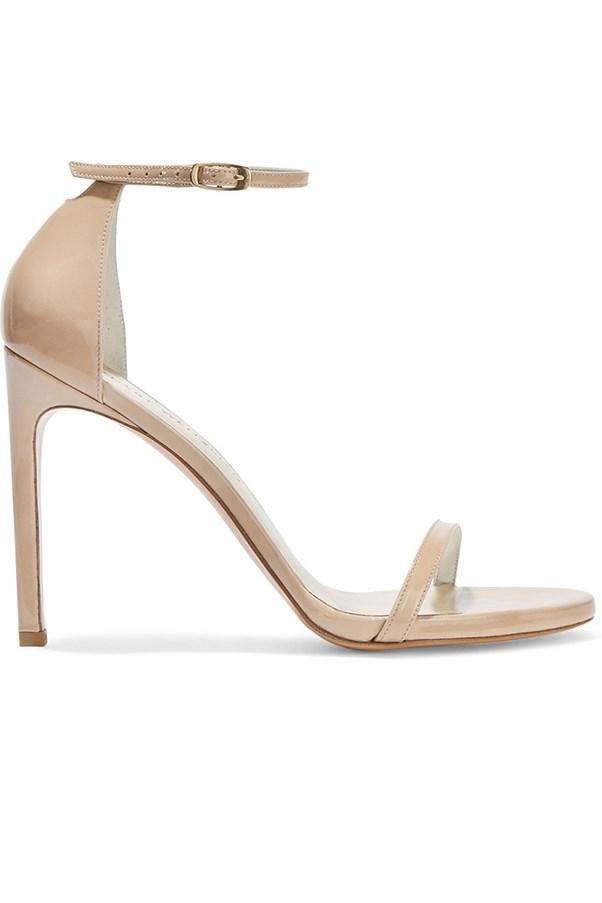 "<strong>Ankle-Strap Sandals</strong> <br><br> Stuart Weitzman sandal, $577, <a href=""https://www.net-a-porter.com/au/en/product/692693/stuart_weitzman/nudistsong-patent-leather-sandals?cm_mmc=LinkshareUK-_-TnL5HPStwNw-_-Custom-_-LinkBuilder&siteID=TnL5HPStwNw-1KdD04.gni3FgwrHY6bEKw"">net-a-porter.com</a>."
