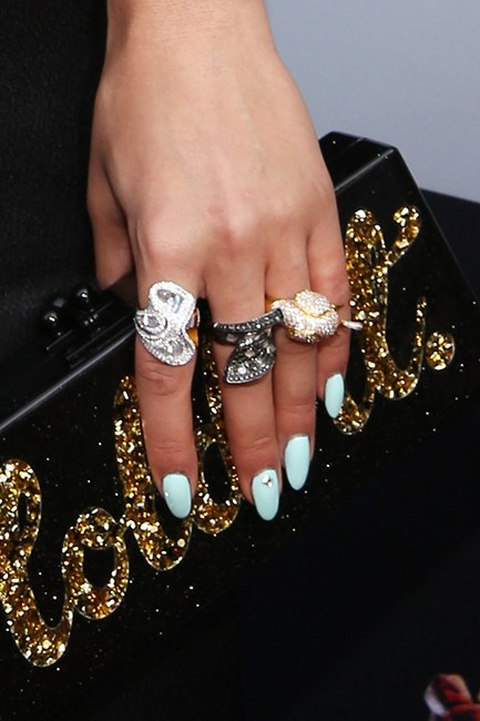 <p><strong>If you're wearing a black dress…</strong> Have some fun with your nails! Go bright. Coral, pink and blue shades will all make a fun statement. If you're willing, experiment with a little nail art by mixing shades and prints.</p>