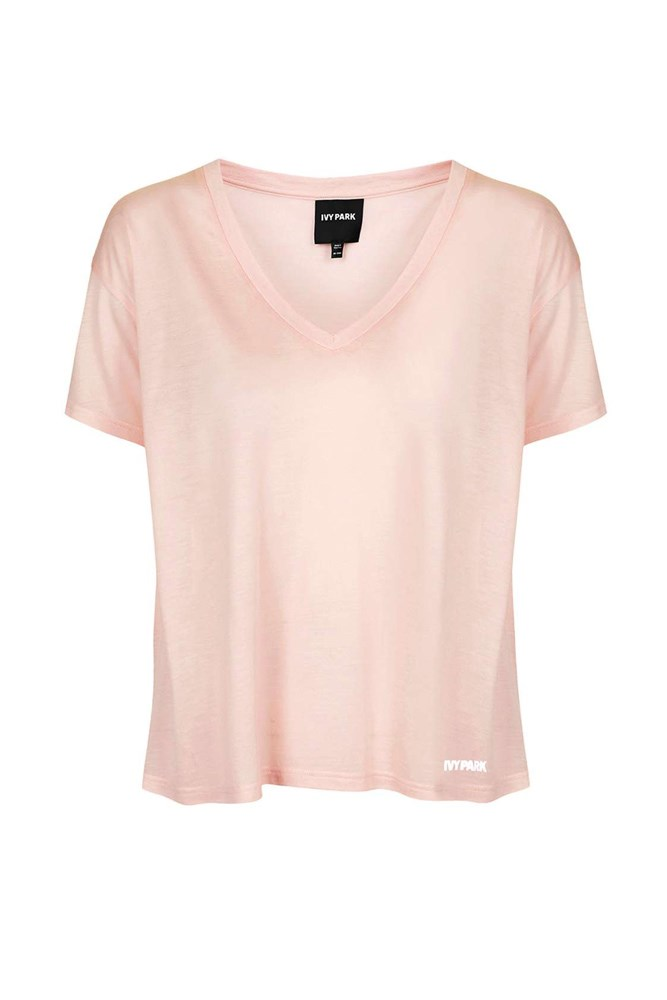"""<a href=""""http://www.topshop.com/en/tsuk/product/clothing-427/ivy-park-5463599/oversized-v-neck-tee-by-ivy-park-5455327?bi=140&ps=20"""">Tee, approx. $28, Ivy Park at topshop.com</a>"""