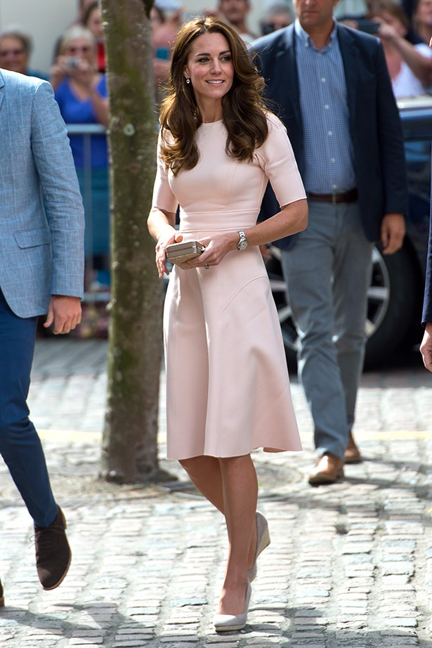Kate Middleton stepped out yesterday in a pale-pink Lela Rose fit and flare dress, which she paired with grey wedges and a Cartier watch.