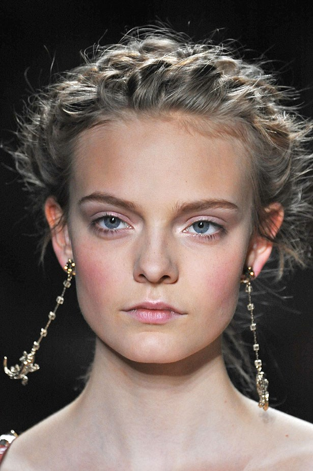 <P> THE WHIMSICAL BRIDE<P> <P> Embrace the whimsy and pair a braided up-do with a fresh face, a pink blush on the apples of your cheeks, and bare eyes. A flash of white-toned shimmer in the inner-corners will open up the eyes. Bronzer optional.