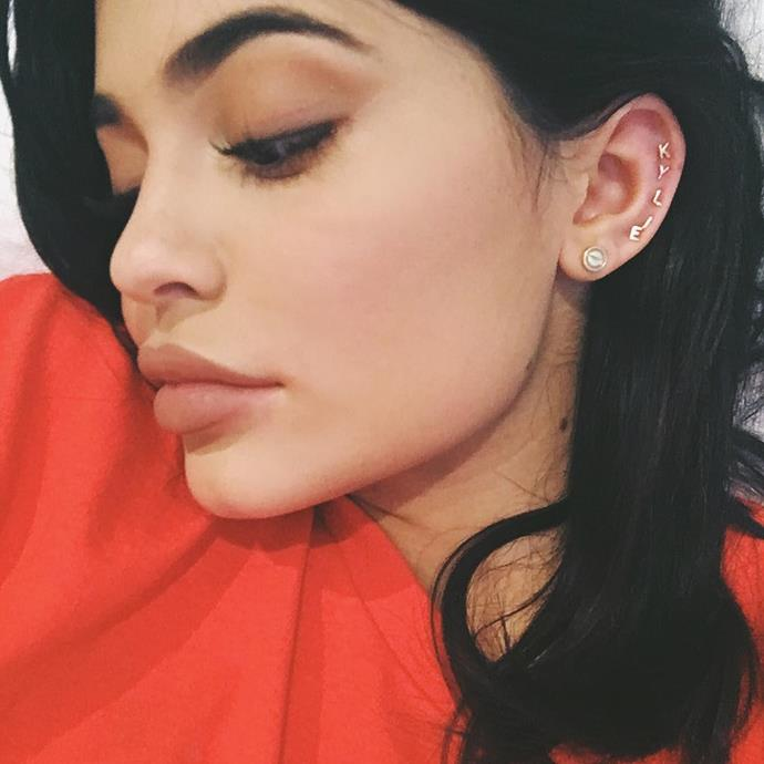 <p>Kylie Jenner has enough piercings in her left ear that she can spell out her name. She also has an industrial piercing in her right ear.