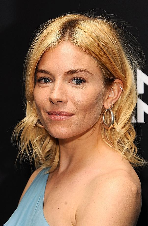 <p>Sienna Miller has at least three lobe piercings and one helix in her left ear.