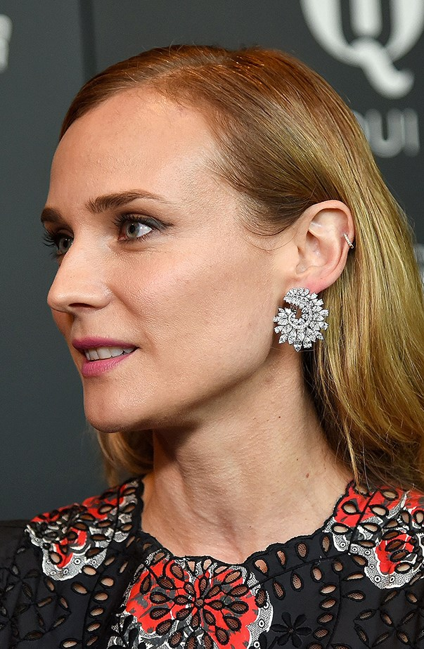 <p>Diane Kruger usually wears a little gold or diamond hoop in her left helix piercing.