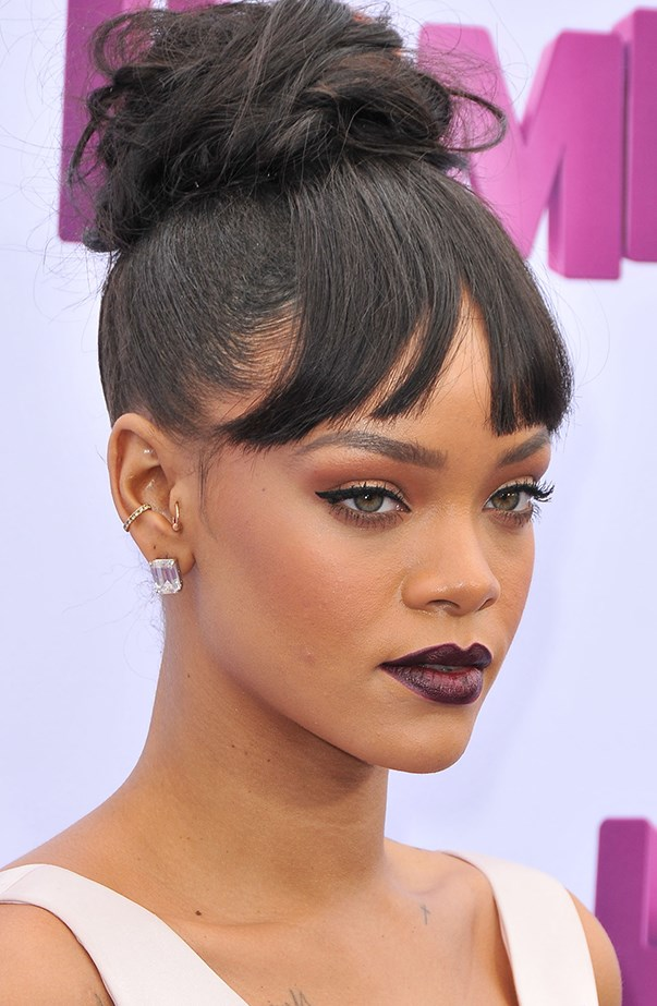 <p>Rihanna has at least four piercings in her right ear, including a conch and tragus piercing.