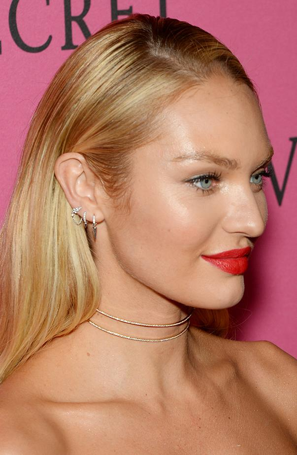 <p>We love the pretty way Candice Swanepoel has decorated the three lobe piercings in her right ear.