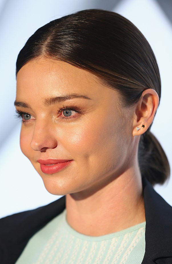 <p>Miranda Kerr wears delicate studs in her two lobe piercings.