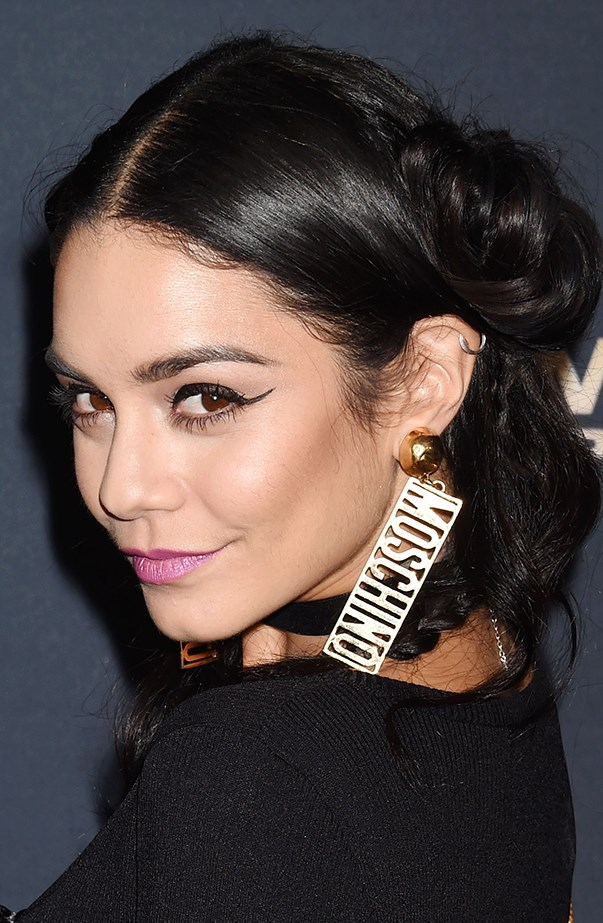 <p>Vanessa Hudgens keeps things edgy with a silver helix piercing.