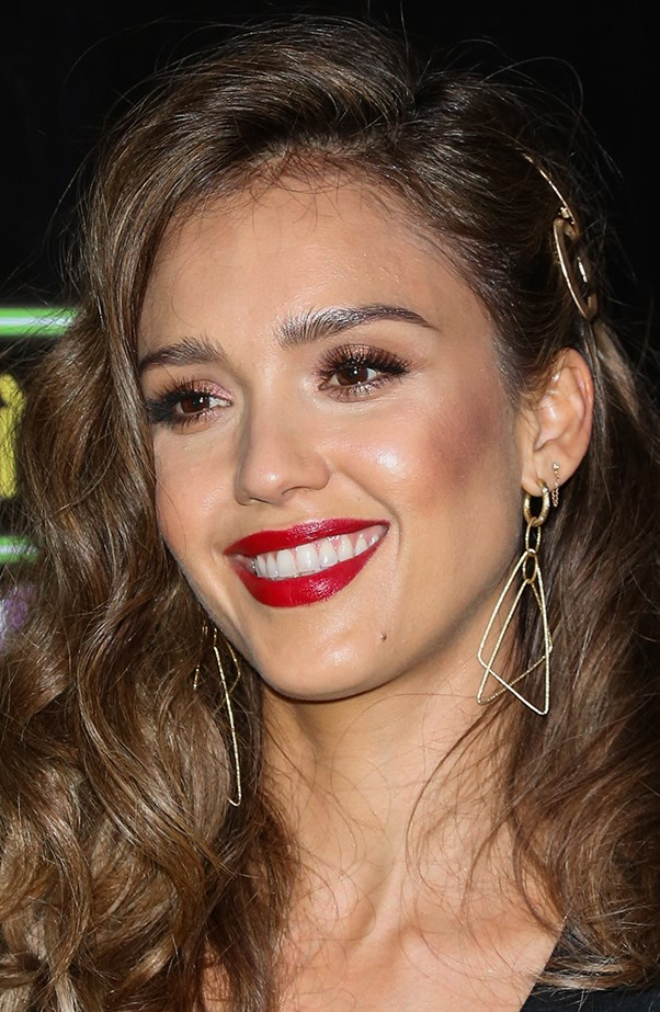<p>Jessica Alba mixes it up with her double lobe piercings.