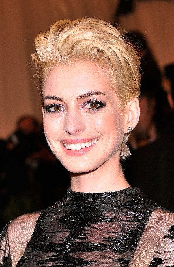 <p>Anne Hathaway made a dramatic appearance at the 2013 Met Gala by debuting this bleach blonde hair look. She went all out for the year's 'PUNK: Chaos to Couture' theme.