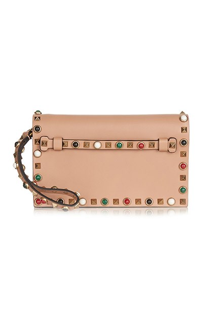 """A nude clutch complements any outfit. <br><br>Clutch, $2,497, <a href=""""http://www.matchesfashion.com/au/products/Valentino-Rockstud-Rolling-small-leather-clutch-1047404"""">Valentino at matchesfashion.com</a>"""