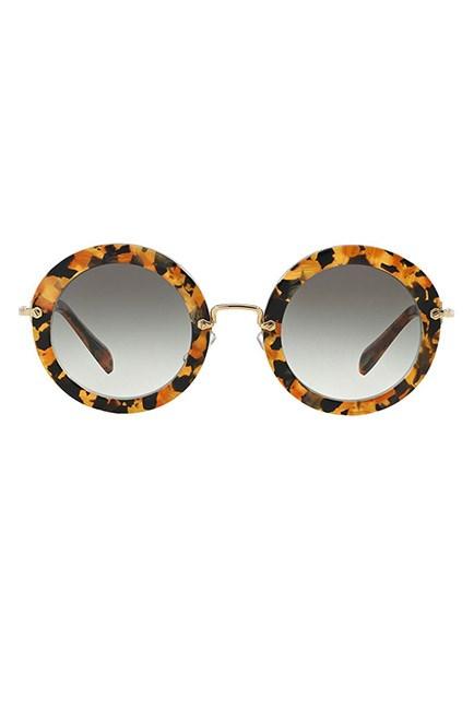"""Sunnies and SPF: two race day essentials. <br><br>Sunglasses, $442, <a href=""""https://www.farfetch.com/au/shopping/women/miu-miu-eyewear-round-frame-sunglasses--item-11321275.aspx?storeid=9749&from=listing&rnkdmnly=1&ffref=lp_pic_5_6_"""">Miu Miu at farfetch.com </a>"""