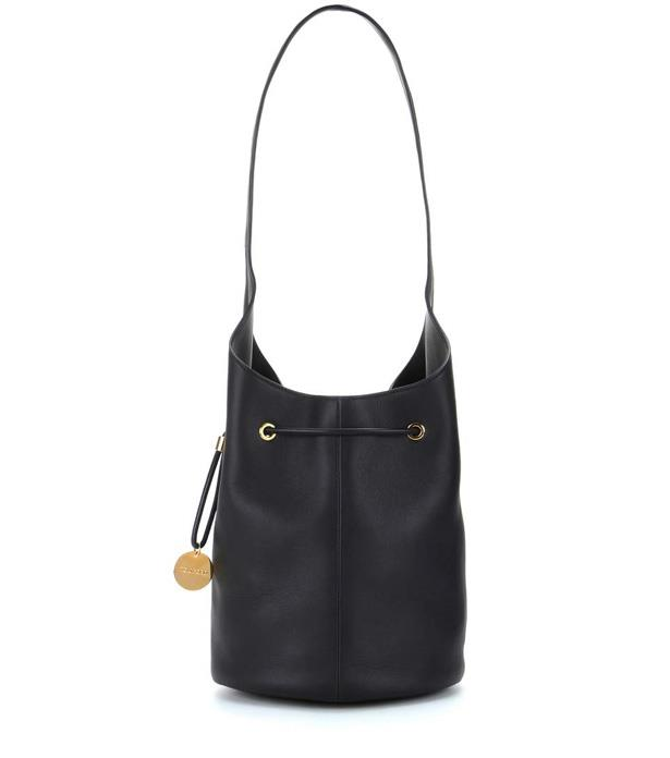 """<p>Instead of rummaging through pockets and zippers before an impatient check-in staffer, throw everything into a chic bucket bag.<p><br> <a href=""""http://www.mytheresa.com/en-au/leather-bucket-bag-625939.html?catref=category"""">Bucket bag, $3,515, Tom Ford at mytheresa.com</a>"""