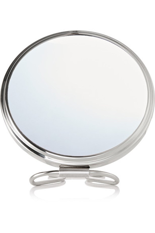 "<p>There needn't be any downtime between stepping off your flight and hitting your next appointment. This double-sided mirror lets you apply your makeup flawlessly whilst sky-high, and it comes with a velvet travel case for in-flight safety.<p><br> <a href=""https://www.net-a-porter.com/au/en/product/649298/frasco_mirrors/double-sided-travel-mirror"">Mirror, $236, Frasco Mirrors at net-a-porter.com</a>."