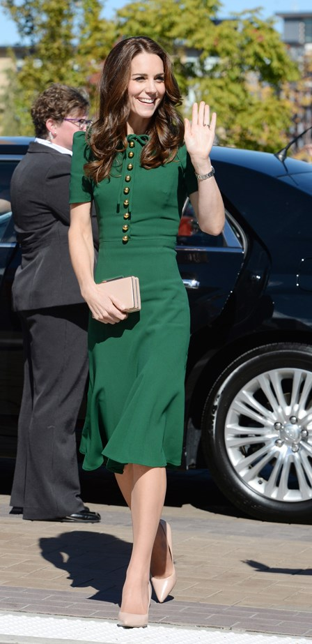 Kate chose this bottle green Dolce and Gabbana dress to visit the Kelowna University campus.