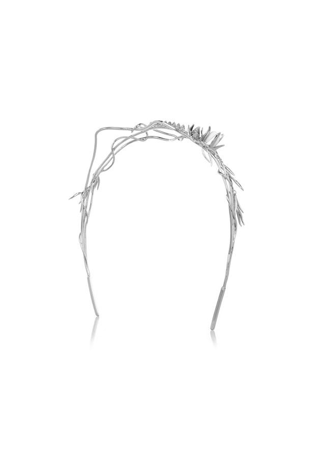 "<a href=""https://www.theoutnet.com/en-US/product/Eddie-Borgo/Climbing-Rose-silver-plated-cubic-zirconia-headband/607531"">Headband, $320, Eddie Borgo at theoutnet.com</a>."