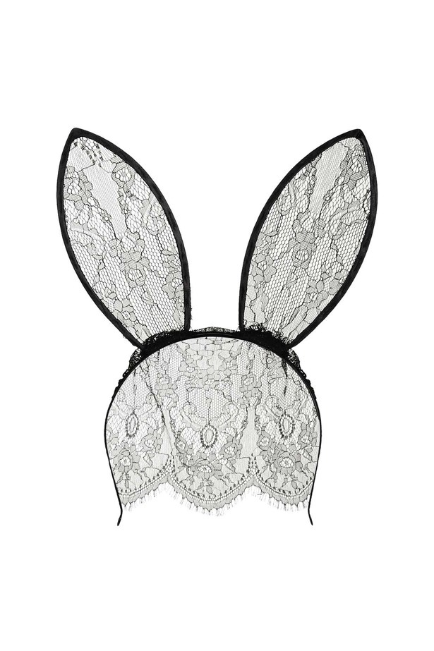 """<a href=""""http://www.topshop.com/en/tsuk/product/bags-accessories-1702216/hair-accessories-464/lace-veil-bunny-ears-hairband-5932740?bi=0&ps=20"""">Hairband, $20, Topshop.</a>"""