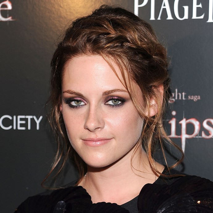 <p>Kristen Stewart wore this messy braided 'do to a premiere. The braids came together in a low bun.