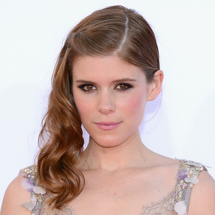 <p>Kate Mara's hairstyle has a waterfall braid, plaits and a bun, yet it all somehow comes together beautifully.