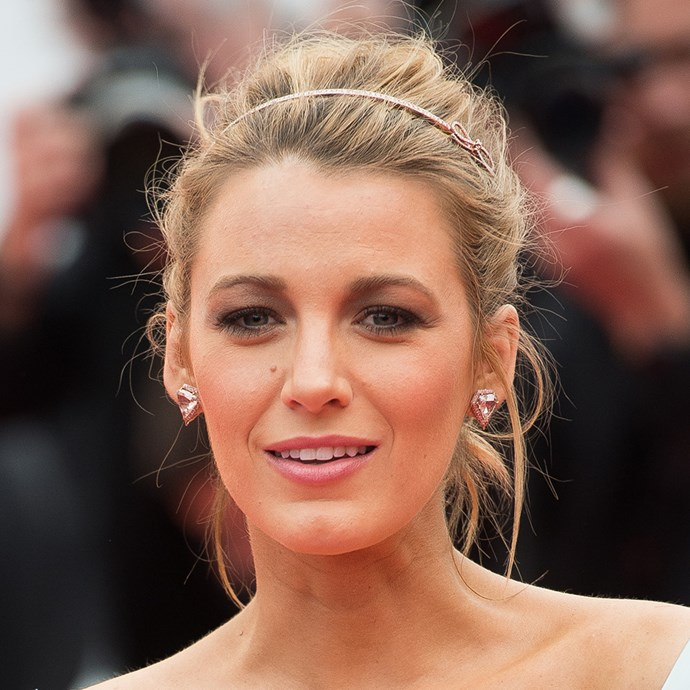 <p>Blake Lively's messy bun leaves room for accessories and a tiara.