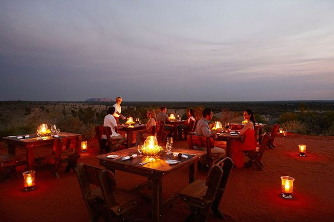 "<strong>Tali Wiru, NT</strong> <br><br>What could be more romantic than watching the sun set over Uluru? How about a candlelit table, premium Australian wine and a fine-dining menu? Dinner at Tali Wiru is a once-in-a-lifetime experience. <br><br><strong><a href=""https://www.ayersrockresort.com.au/experiences/detail/tali-wiru"">ayersrockresort.com.au</a></strong>"