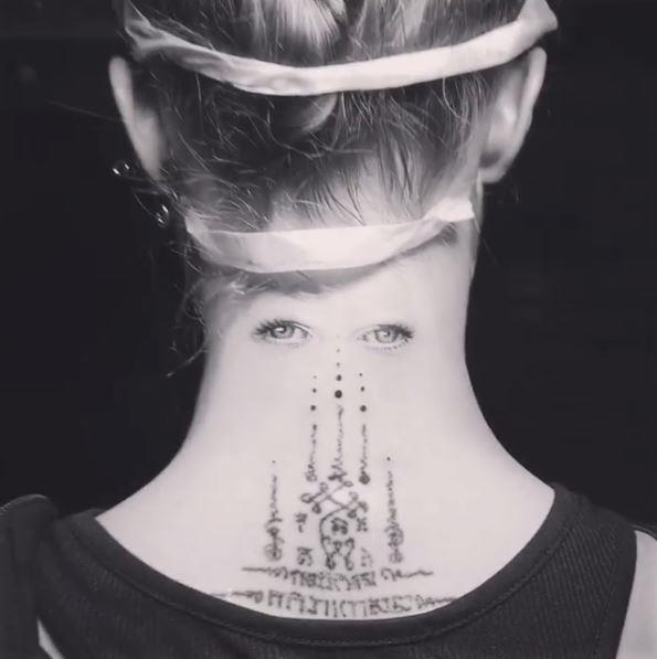 Cara Delevingne debuted her latest tattoo on Instagram, a pair of eyes on the back of her neck.