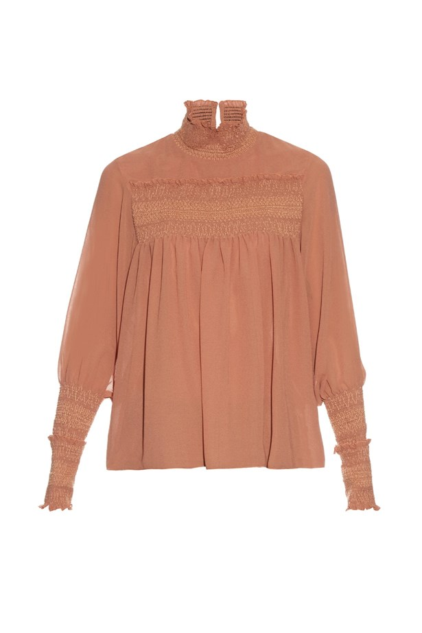 "Blouse, $306, <a href=""http://www.matchesfashion.com/au/products/See-By-Chlo%C3%A9-Smocked-high-neck-crepe-blouse-1056674"">See by Chloé at matchesfashion.com</a>."