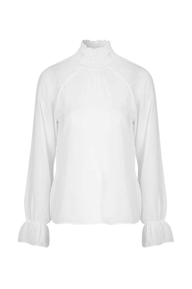 "Blouse, $53, <a href=""http://www.topshop.com/en/tsuk/product/clothing-427/tops-443/raglan-blouse-by-motel-5448892?bi=120&ps=20"">Topshop</a>."