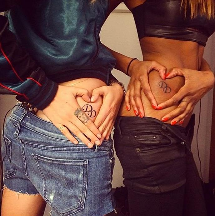 **Jourdan Dunn and Cara Delevingne** <br><br> Jourdan Dunn and Cara Delevingne got matching 'DD' tattoos—for their combined last names.