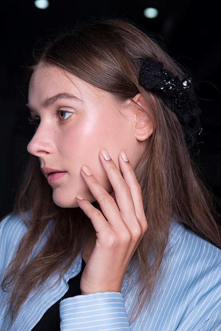 """This fun and fashionable glitter manicure (or cuticle jewellery to give it its official title) from the <strong>Rodarte</strong> sisters is perfect for party season. Leave nails bare or apply a coat of clear polish and dot chunky gold glitter around your cuticles. Try <a href=""""https://www.adorebeauty.com.au/nails-inc/nails-inc-alexa-fabric-polish-sequins.html"""">Nails Inc Alexa Fabric Polish</a>, $26.29."""
