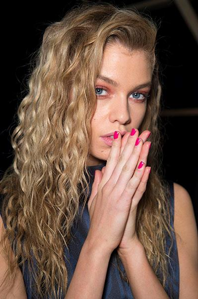 """Pop pink nails are always a winner in spring. They work just as well with your denim cut-offs as they do trackside. Keep them on-trend with a high-shine top coat and a co-ordinating wash of pink on the lids à la Stella Maxwell at <strong>Unique</strong>. Try <a href=""""http://www.sephora.com.au/products/laqa-and-co-bounty-hunter-nail-polish-and-pen-duo/v/bounty-hunter-nail-polish-pen-duo"""">Laqa & Co Bounty Hunter Nail Polish and Pen Duo</a>, $51."""