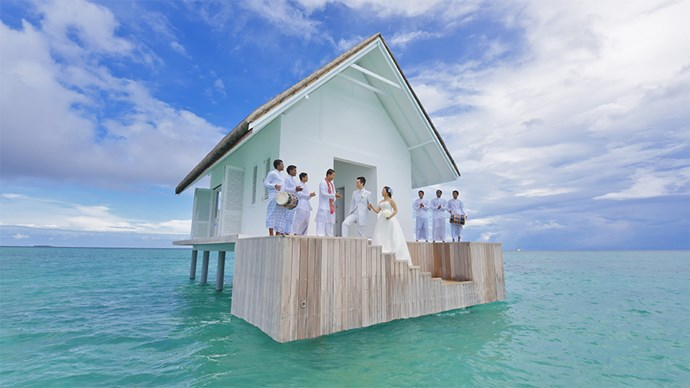 "<p> <a href=""http://www.fourseasons.com/maldiveslg/"">Four Seasons Maldives at Landaa Giraavaru, Maldives</a><p> <p> This 'Floating Church' is offered by the Four Seasons for those who wish to marry over the ocean in this tropical paradise. The church itself can only realistically cater intimate weddings with a few guests, but the picturesque views and dolphin proximity make it worth the while."