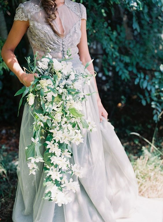 "<p> <em>Cascading</em><p> <p> When most people think of cascading bouquets, their mind drifts to bad '80s decor (or else Kate Middleton's sweet little cascade at her 2011 wedding), but this wild waterfall style is making a chic comeback. If you're planning on going with the flow, choose flowers with natural movement and flexibility like amaranths and seeded eucalyptus.<p> <p> Image via <a href=""https://au.pinterest.com/pin/409686897337297493/"">Pinterest</a>."