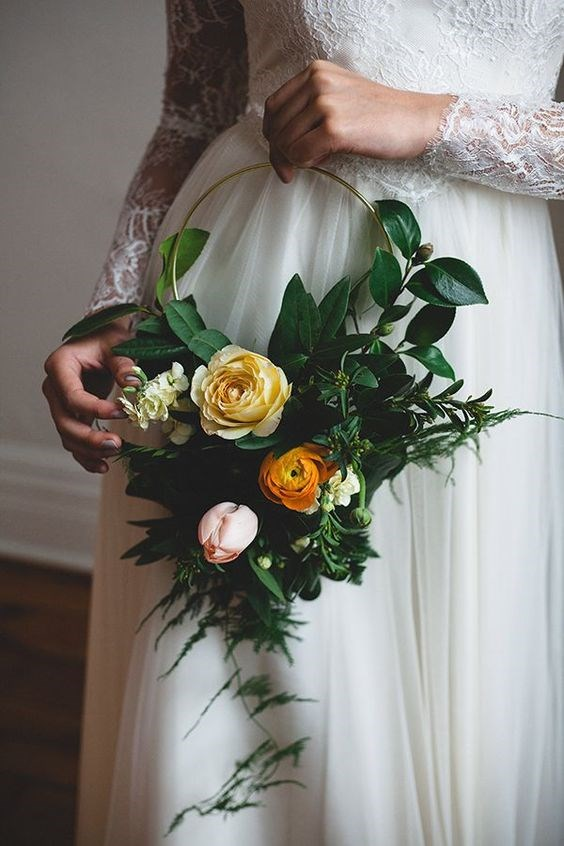 "<p> <em>Hoop</em><p> <p> Whether for your bridesmaids or for yourself, a hoop bouquet is an out-of-the-box alternative to the traditional bouquet-in-hand. Winding flowers and foliage around a gold or silver hoop is a chic, hands-free option for the modern bride.<p> <p> Image via <a href=""https://au.pinterest.com/pin/409686897337297973/"">Pinterest</a>."