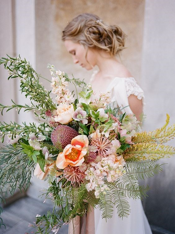 "<p> <em>Oversized</em><p> <p> If the meek posey isn't for you, try this year's most OTT trend: the oversized bouquet. It might be a strain on your arm (or your bridesmaid's) but the effect is magical.<p> <p> Image via <a href=""https://au.pinterest.com/pin/409686897337297498/"">Pinterest</a>."