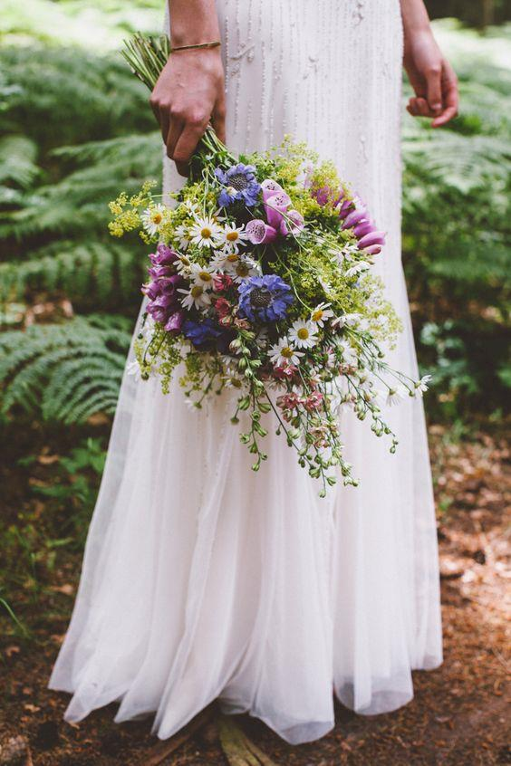 "<p> <em>Wildflowers</em><p> <p> If you're looking to skip the pricetag of a traditional bouquet, a posey of wildflowers is a chic, inexpensive alternative. Whether their gathered from a local field or bought from a store, the romantic effect is a great addition to any bridal party.<p> <p> Image via <a href=""https://au.pinterest.com/pin/409686897337297742/"">Pinterest</a>."