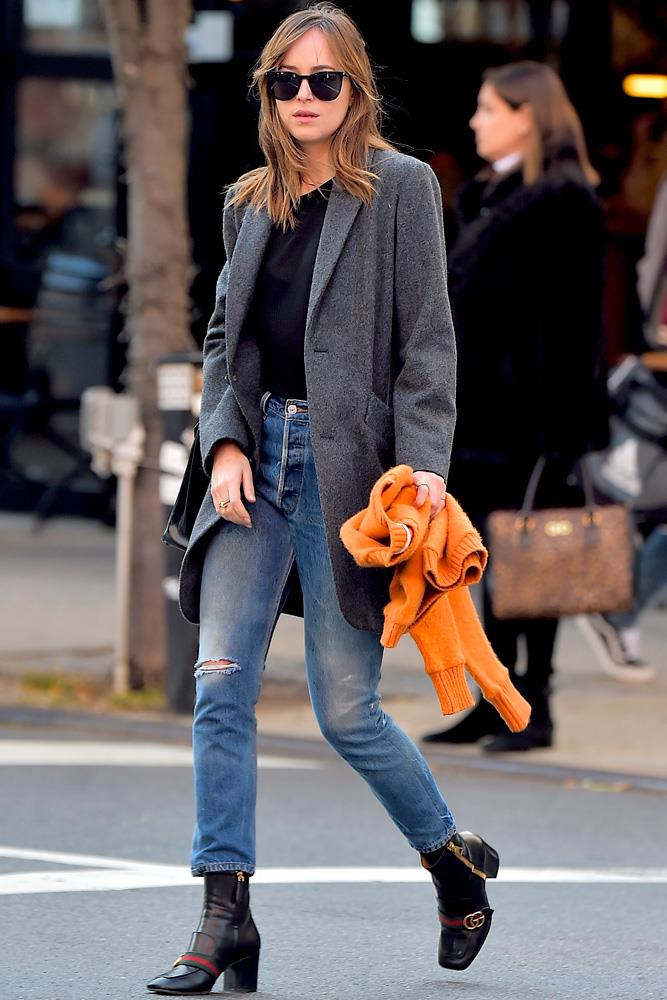 Dakota Johnson's casual-cool style is faultless. Here she wears the Gucci boots of your dreams.