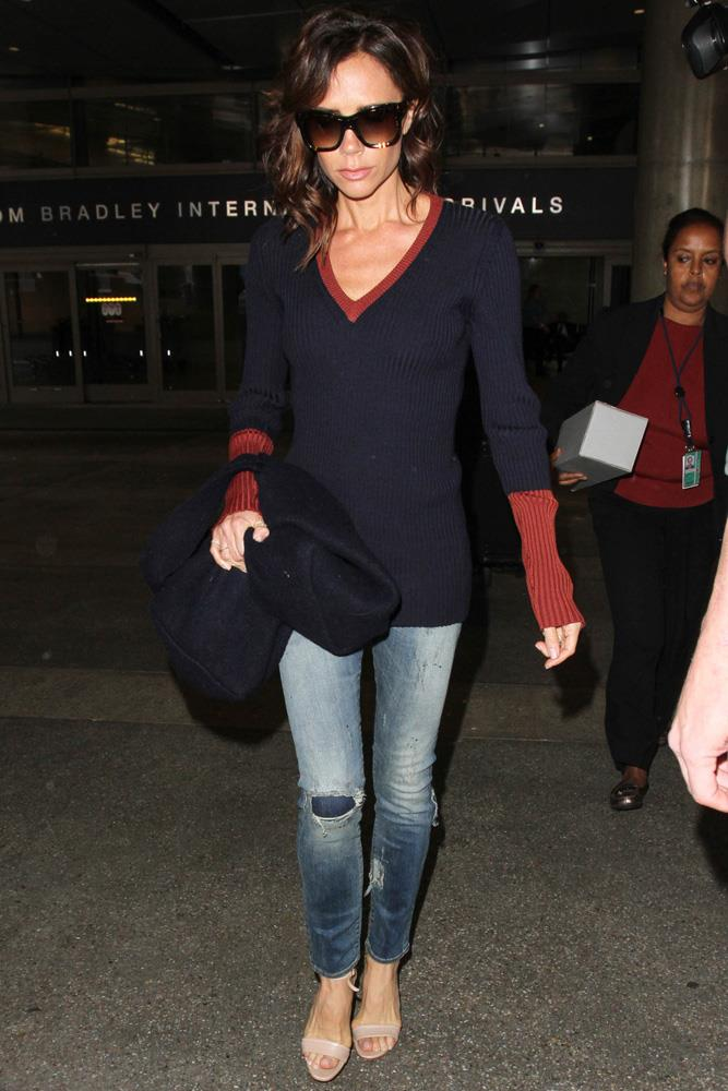 Victoria Beckham adds polish to a jeans-and-sweater combo at LAX.