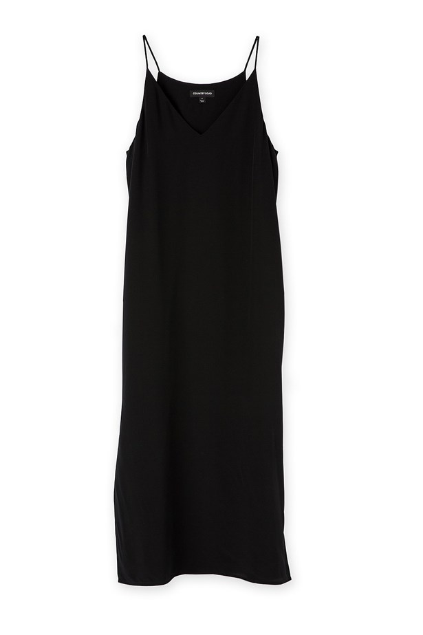 """<p> As your belly grows, a soft, silky slip is the perfection solution to all your wardrobe problems. <p> <p> <a href=""""https://www.countryroad.com.au/shop/woman/clothing/dresses/60207366/Silk-Slip-Dress.html"""">Shirt, $199, Country Road.</a>"""