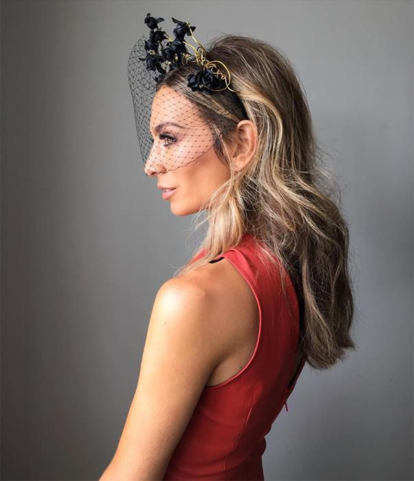 """<p>Nadia Bartel teamed a Scanlan and Theodore dress with a Suzy O'Rourke headpiece for Blue Sapphire Stakes Day. <p><a href=""""https://www.instagram.com/p/BLc8Xv3A-iz/"""">Instagram.com/nadiabartel</a>"""
