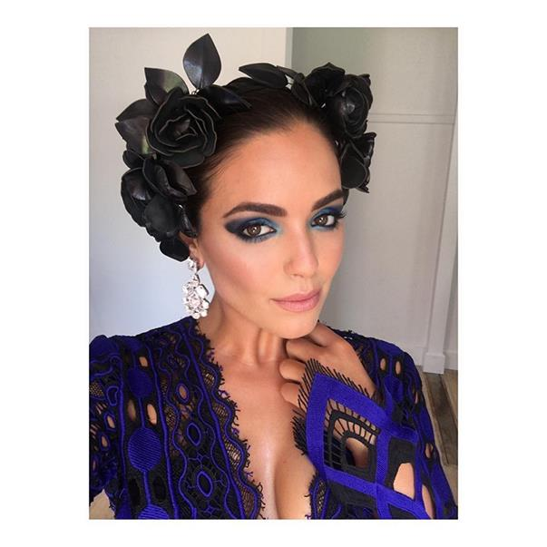 """<p>Olympia Valance was feeling black and blue for Caulfield Cup Day, wearing a Thurley dress and Reny Kestel headpiece. <p><a href=""""https://www.instagram.com/p/BLkLbtJDRMP/"""">Instagram.com/olympiavalance</a>"""