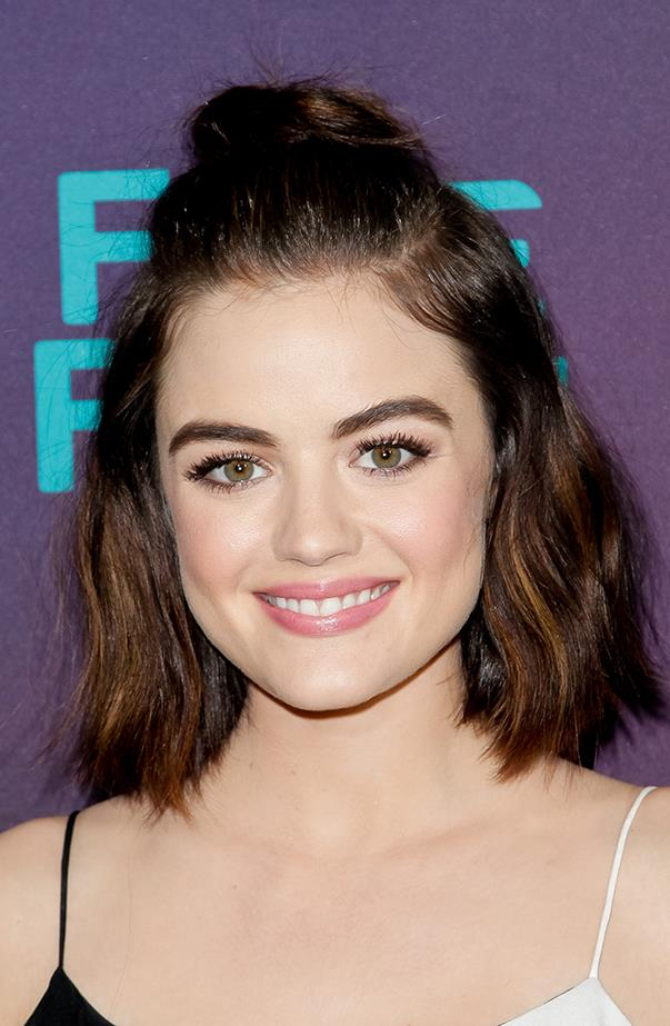 <p>Lucy does cool-girl hair with this half top-knot.